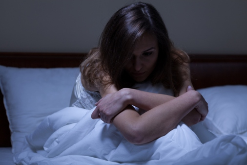 Awake woman suffering from depression